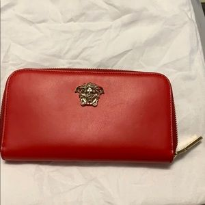 New red leather Versace wallet